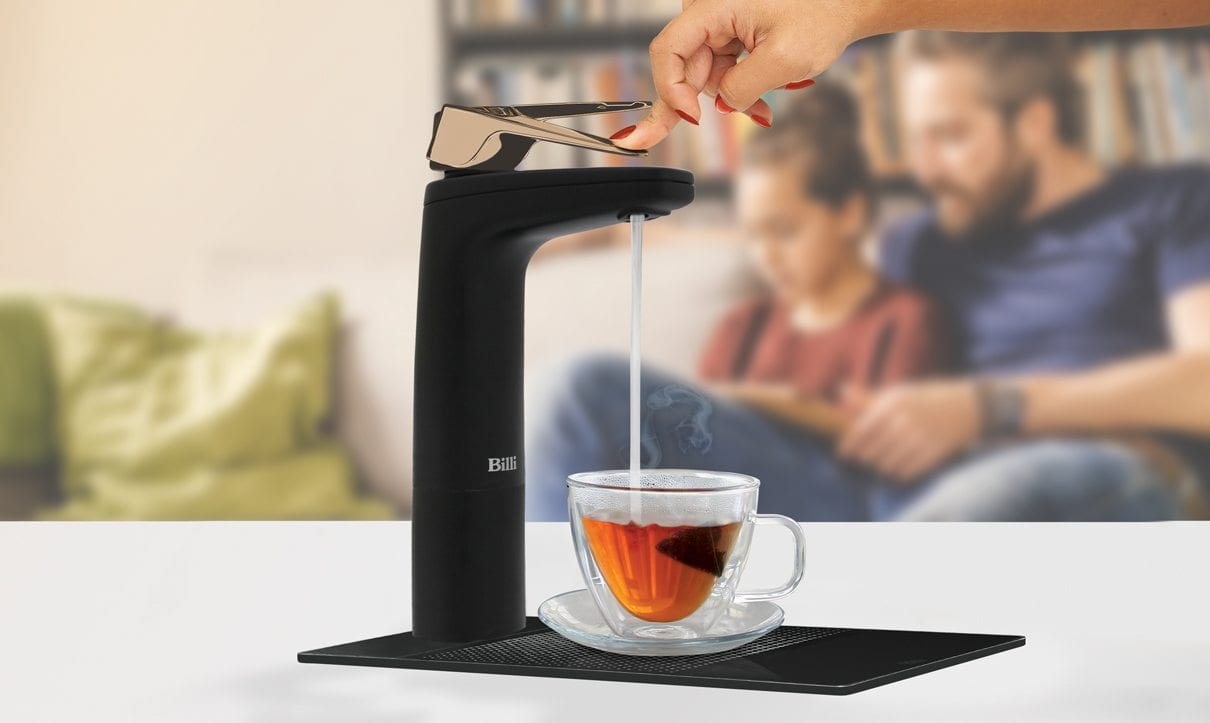Matte Black dispenser filling tea cup with hot water
