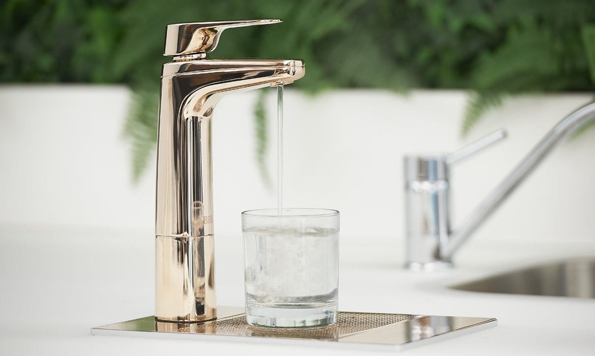Rose Gold XL dispensing chilled water into glass