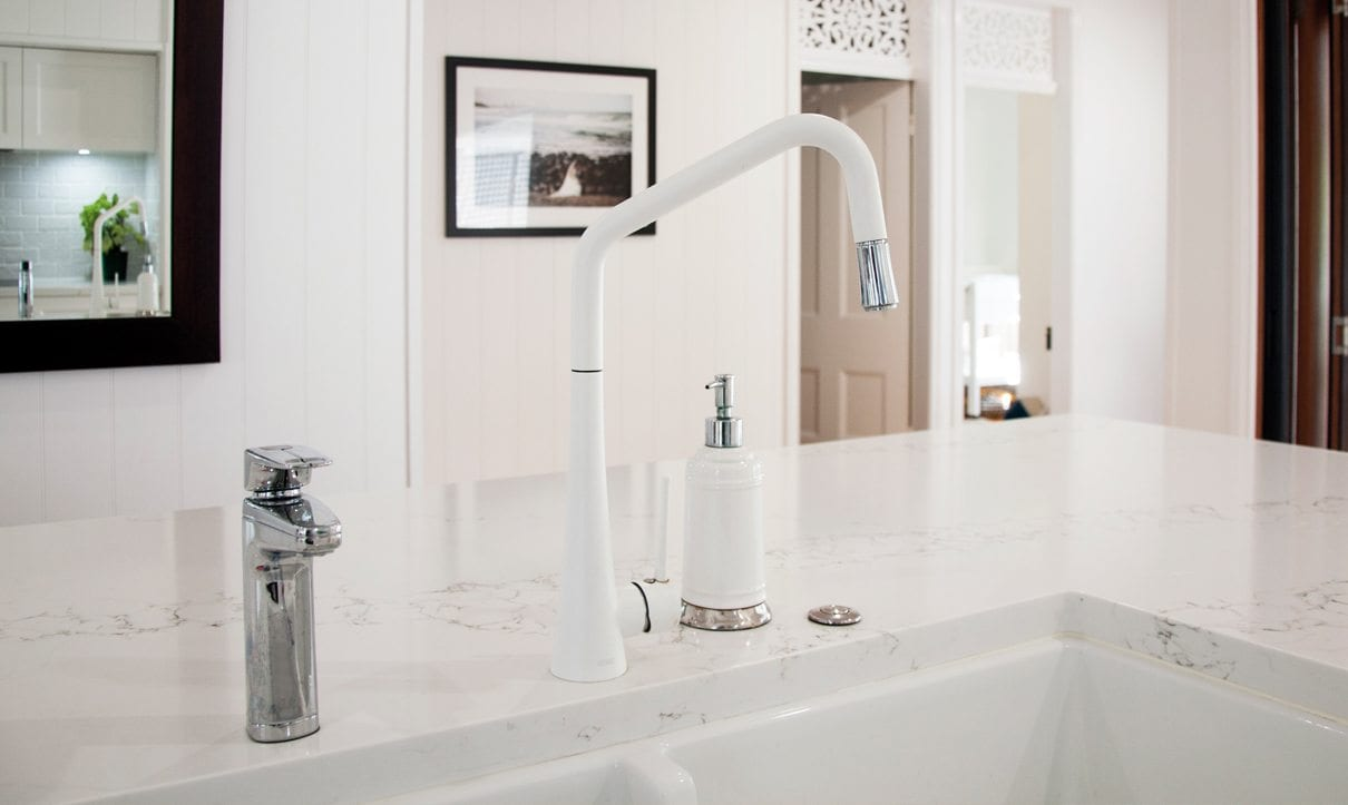 Chrome XL dispensers in marble kitchen bench
