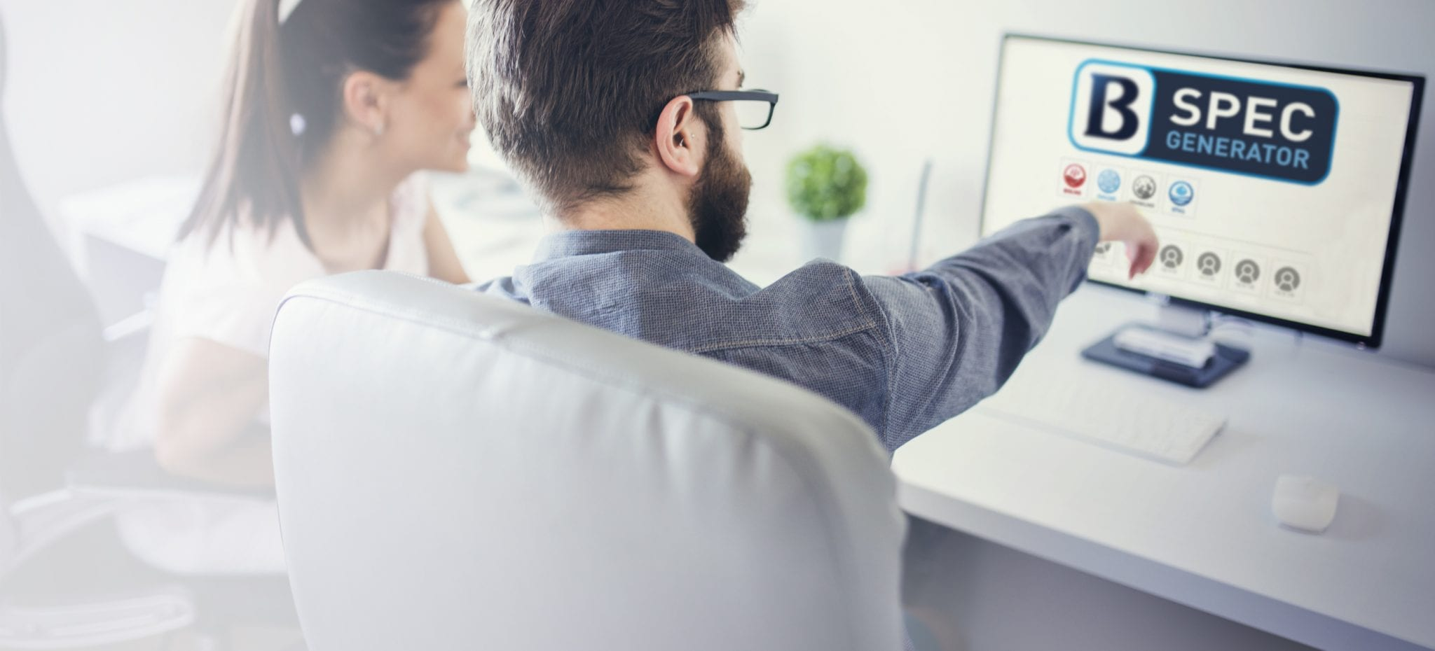 two people looking at the spec generator on computer page