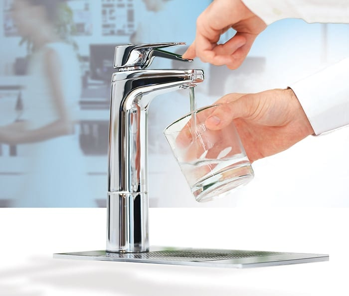 Chrome XL Levered Dispenser with matching riser and font filling glass with filtered water