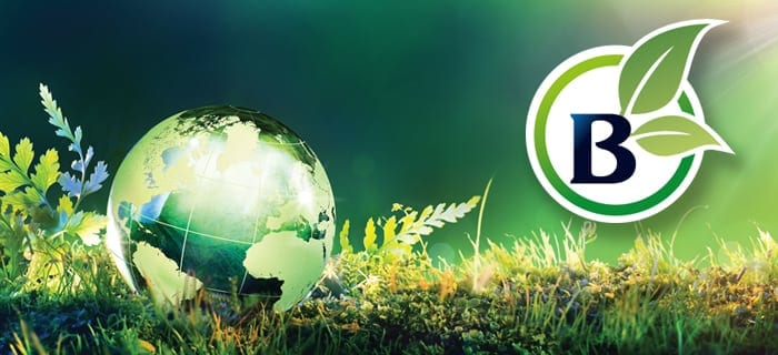 Billi Envrionmentally Focus B logo with globe map on green grass background