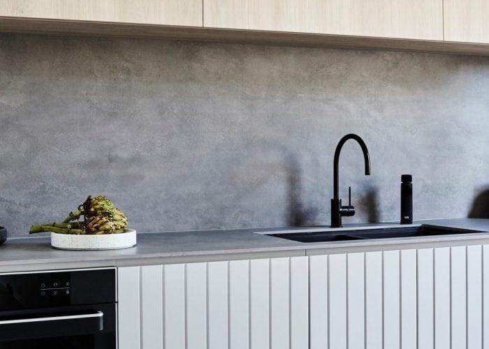 Billi XL Levered Dispenser in matt balck with matching gooseneck mixer on modern kitchen benchtop