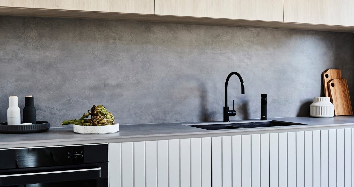 Billi XL Levered Dispenser in matt balck with matching gooseneck mixer on modern kitchen benchtop