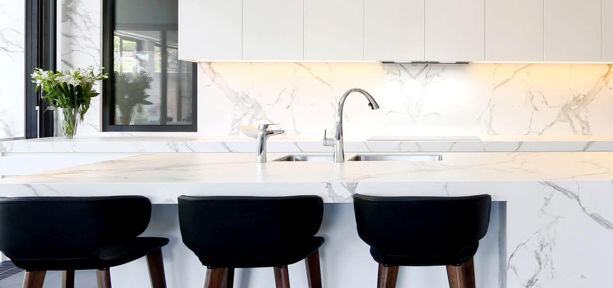 Billi XL dispenser in chrome on marble bench next to mixer tap