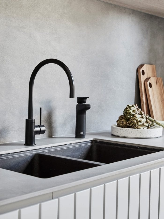 Billi XL Matte Black dispenser on kitchen sink next to mixer tap
