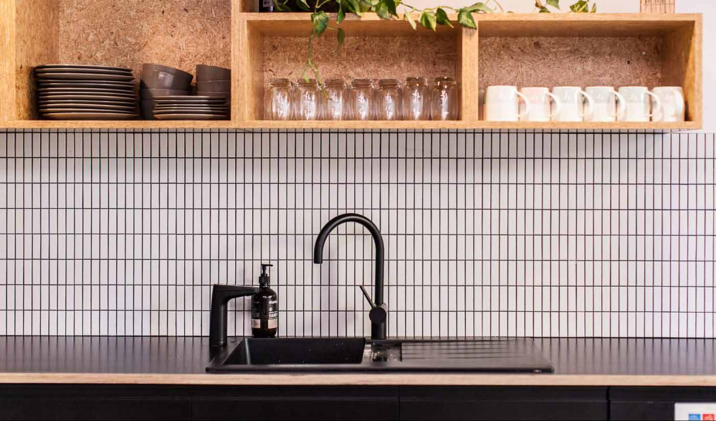 Matte Black XL dispenser on kitchen sink opposite mixer tap