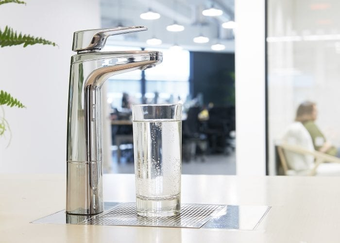 Billi XL Chrome dispenser on font and riser with glass of water