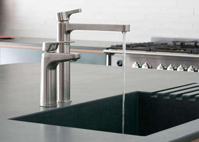 Billi XL Brushed next to mixer tap with running water