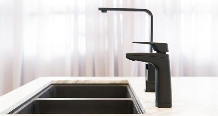 Billi XL dispenser in Matte black on kitchen bench next to mixer tap